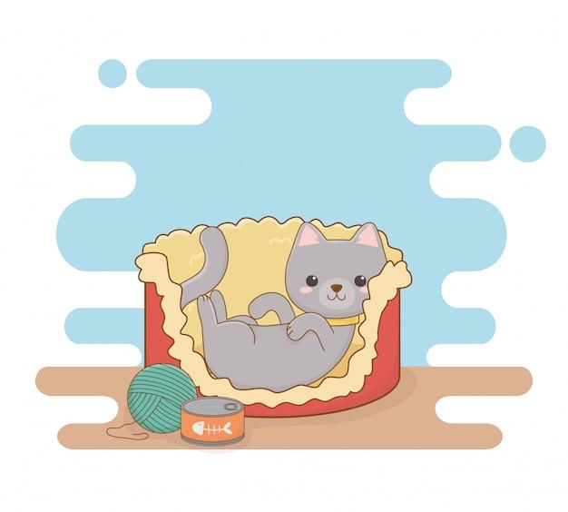 Śliczna mała kot maskotka w łóżku z puszką tuńczyka i wełny rolką Premium Wektorów