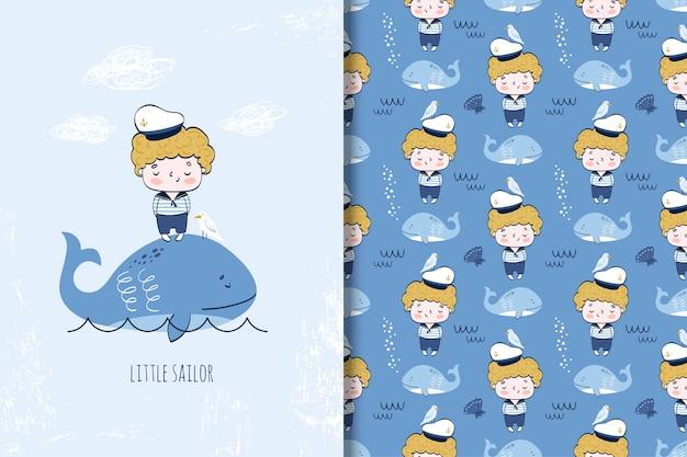 Śliczny chłopiec żeglarz na wielorybiej kreskówki ilustraci bezszwowym wzorze i Premium Wektorów