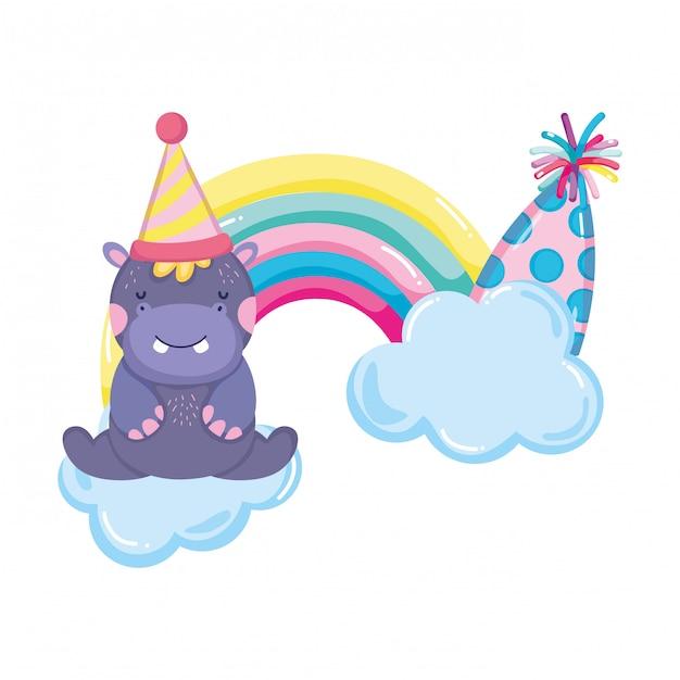 Śliczny i mały hipopotam z imprezowym kapeluszem i tęczą Premium Wektorów