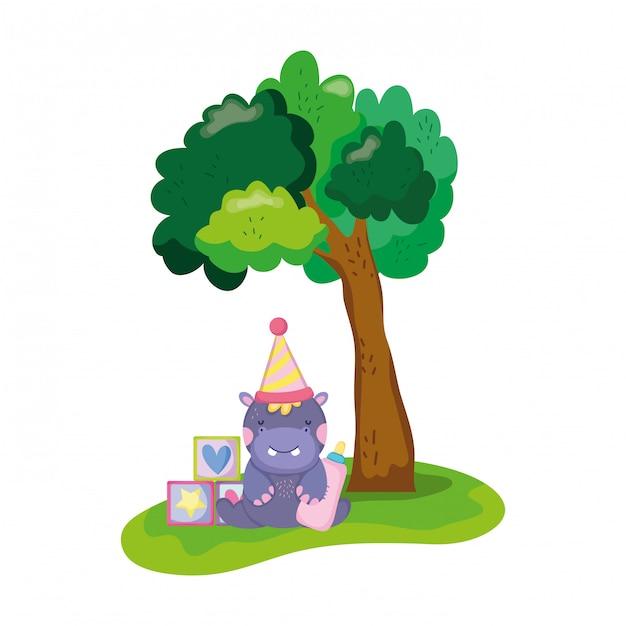 Śliczny i mały hipopotam z kapeluszem partii Premium Wektorów