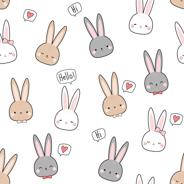 Śliczny królika królika głowy kreskówki doodle bezszwowy wzór Premium Wektorów