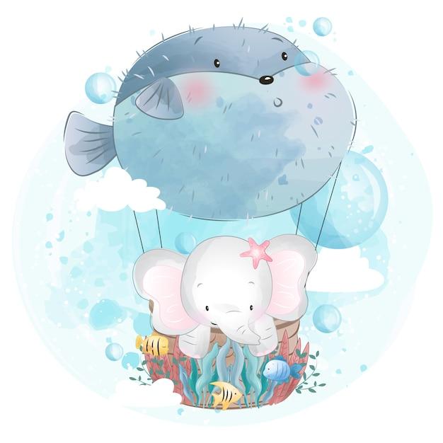 Śliczny słonia latanie z ryba balonem Premium Wektorów
