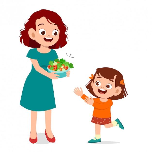 Śliczny Szczęśliwy Dzieciak Je Sałatki Premium Wektorów