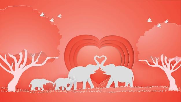 Słonie pokazują miłość na czerwonym tle serca. Premium Wektorów