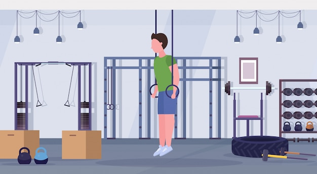 Słowa Kluczowe: Gym Robić Studio Mężczyzna Pierścionki Trening Gym Facet Pierścionki Zdrowy Pojęcie Horyzontalny Gimnastyki Z Zanurzanie Facet Nowożytny Wnętrze Długość ćwiczenie Folował Długość Premium Wektorów