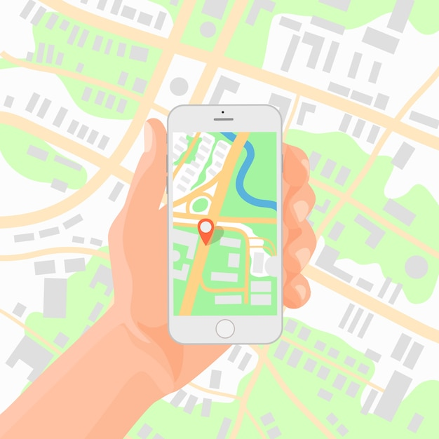 Smartphone w dłoni z mapą nawigacyjną Premium Wektorów