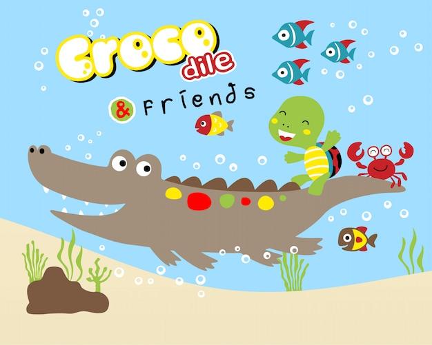 Śmieszna krokodyl kreskówka z małymi przyjaciółmi Premium Wektorów
