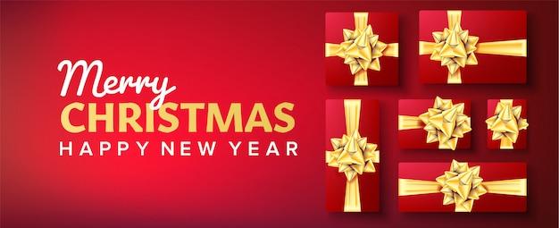 Świąteczny baner. pudełko z złotym łukiem. czerwone tło Premium Wektorów