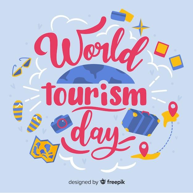 Światowy dzień turystyki napis z obiektami podróży Darmowych Wektorów