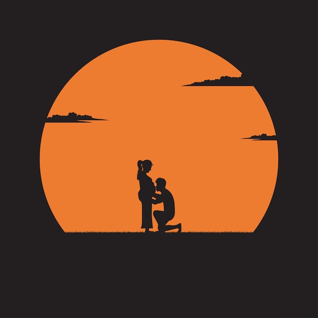 Sylwetka młody człowiek całuje brzuch ciężarnej żony na tle zachodu słońca Premium Wektorów