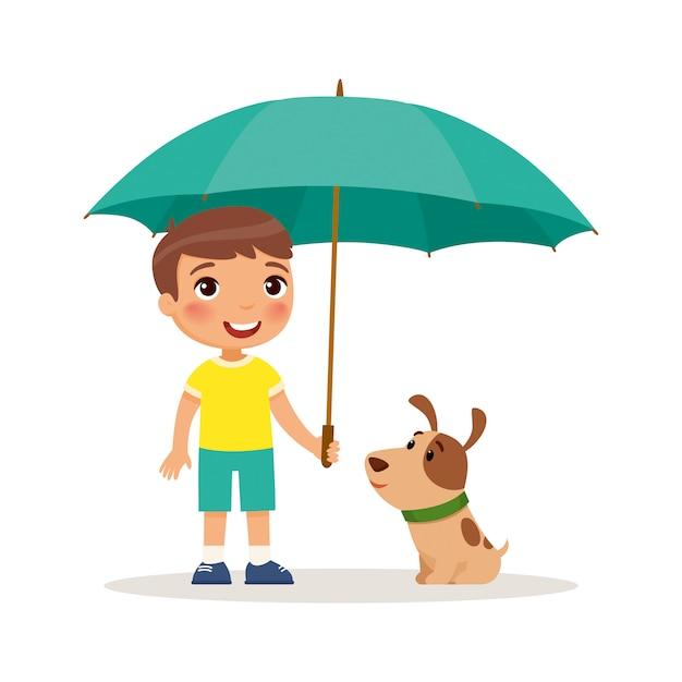 Szczeniak i śliczna chłopiec z żółtym parasolem. szczęśliwa szkoła lub przedszkolak i jej zwierzątko gra razem. zabawna postać z kreskówki. Premium Wektorów