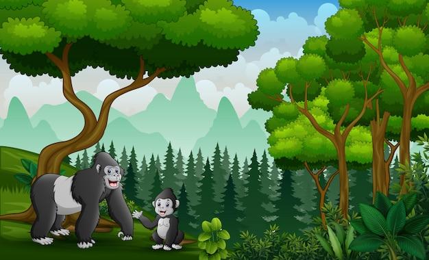 Szczęśliwa Matka Goryla Z Dzieckiem W Dżungli Premium Wektorów