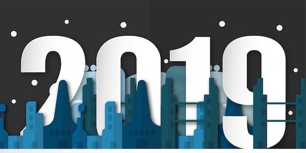 Szczęśliwa nowy rok 2019 dekoracja przy nocą z miastowym miastem w papieru cięciu i cyfrowym rzemiośle. Premium Wektorów