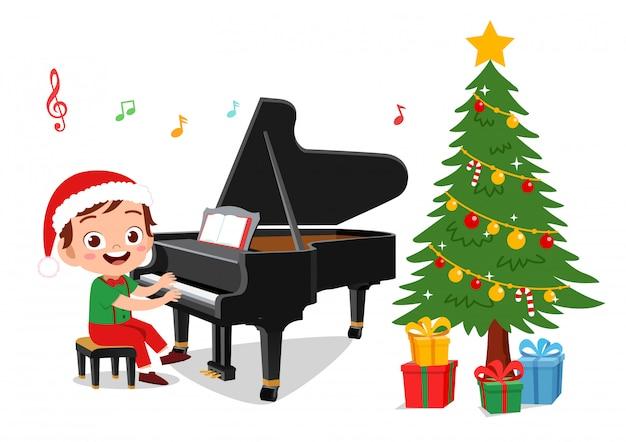 Szczęśliwe dzieci śpiewają podczas świąt bożego narodzenia Premium Wektorów