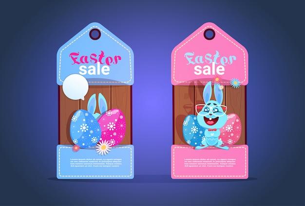 Szczęśliwe wielkanocne tagi sprzedaży z sezonową rabatową śliczną króliczką i jajkami colofrul Premium Wektorów