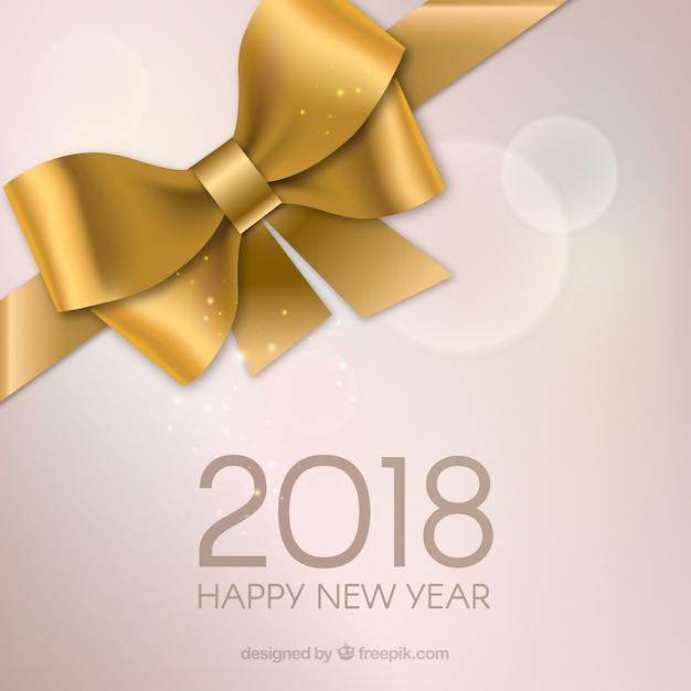 Szczęśliwego nowego roku z kokardą złoty prezent Darmowych Wektorów