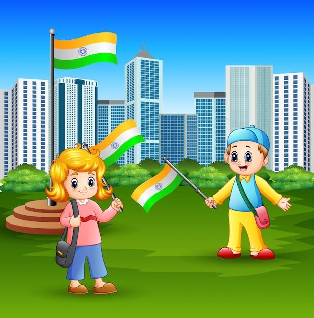 Szczęśliwi dzieciaki trzyma flaga państowowa na miasto parku Premium Wektorów