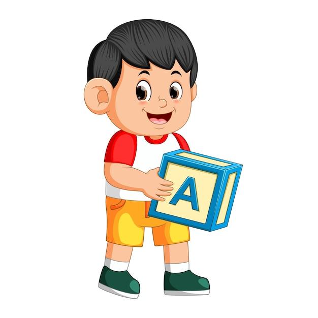 Szczęśliwy Chłopiec Trzyma Kostkę Alfabetu Premium Wektorów