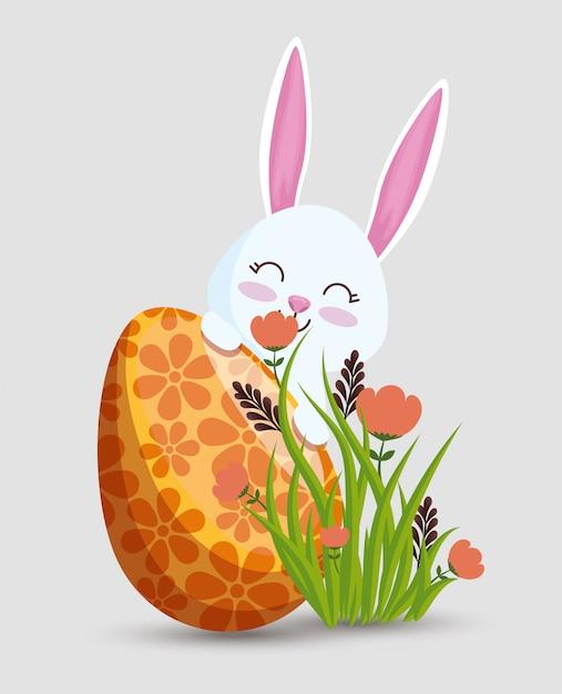 Szczęśliwy królik z jajkową dekoracją i kwiatami Darmowych Wektorów
