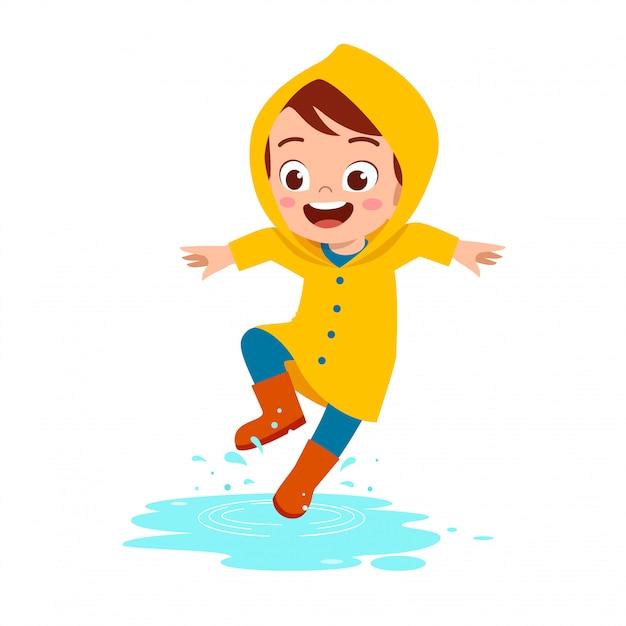 Szczęśliwy ładny Dzieciak Chłopiec Grać Nosić Płaszcz Przeciwdeszczowy Premium Wektorów