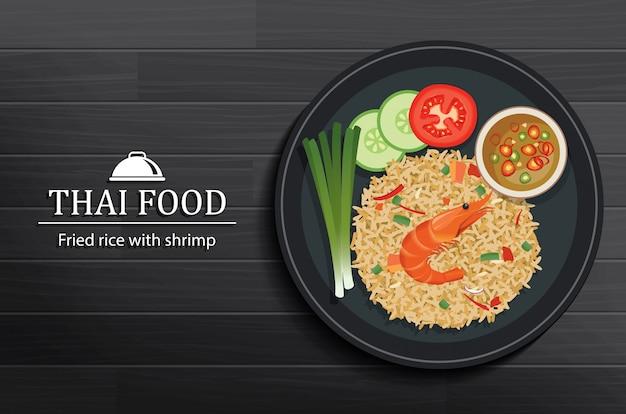 Tajlandzki jedzenie w naczyniu na czarnym drewnianym stołowym odgórnym widoku Premium Wektorów
