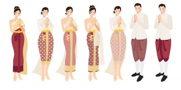 Tajski ślub para pozdrowienia sawasdee w tradycyjnym stroju Premium Wektorów