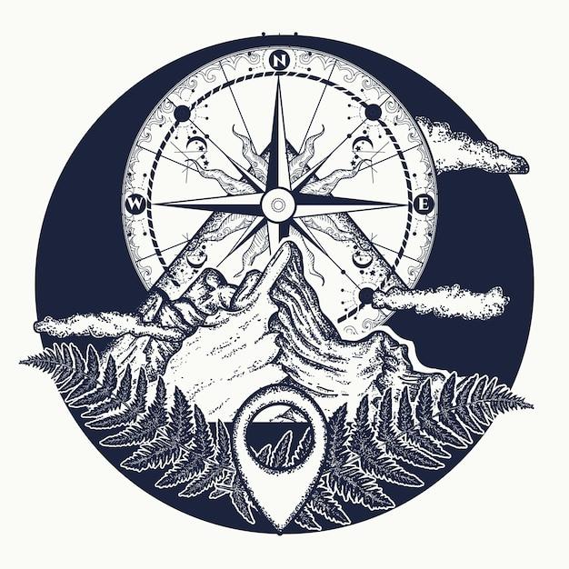 Tatuaż na szczycie góry i kompas Premium Wektorów