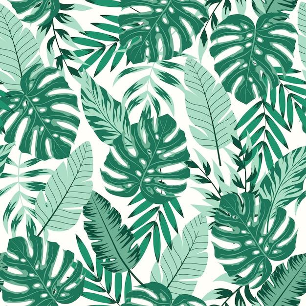 Trendu bezszwowy wzór z tropikalnymi liśćmi na ciemnym tle Premium Wektorów