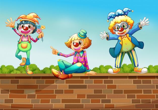 Trzech Klaunów Nad ścianą Darmowych Wektorów