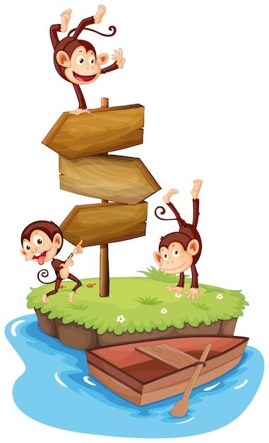 Trzy Małpy I Drewniane Znaki Na Wyspie Darmowych Wektorów