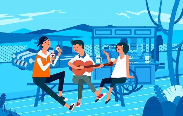 Trzy osoby spędzające czas na straganie z jedzeniem na ulicy podczas gry na gitarze Premium Wektorów