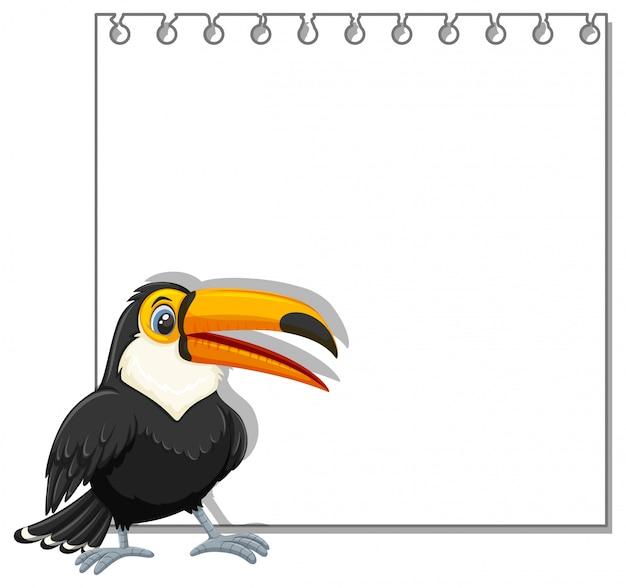 Tukan na pustym notatniku Premium Wektorów