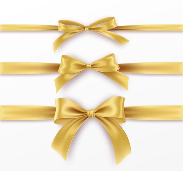 Ustaw Złoty łuk I Wstążki Na Białe Tło. Realistyczny Złoty łuk. Premium Wektorów