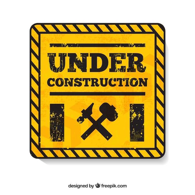 W budowie żółtym symbolem Darmowych Wektorów