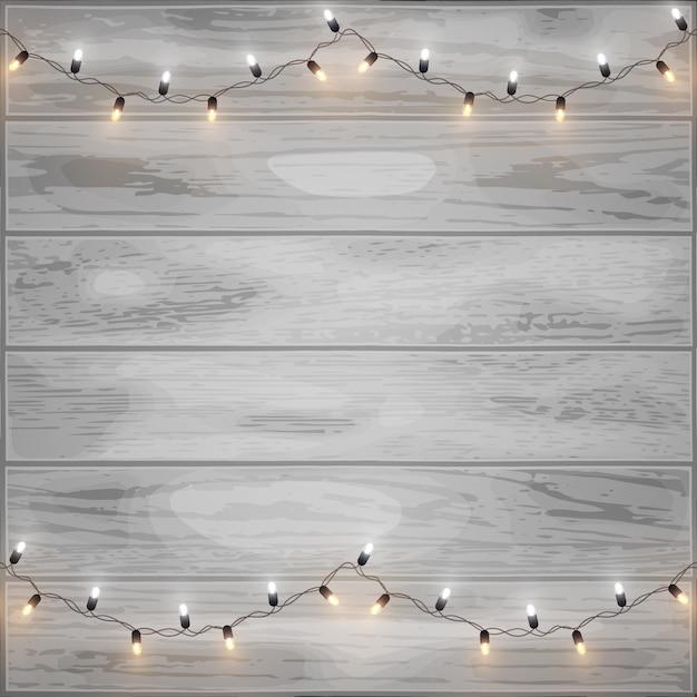 Wesołych świąt błyszczące światła led na tle drewna Premium Wektorów