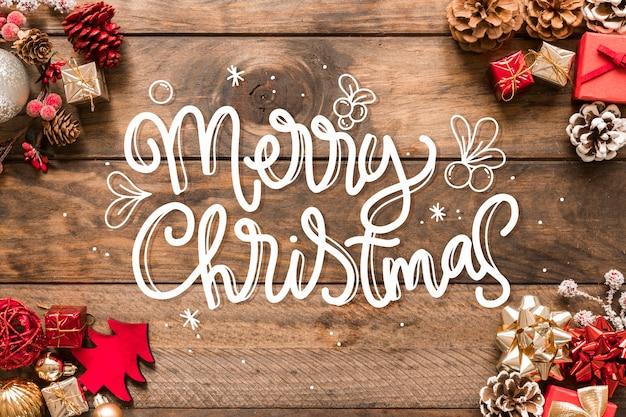 Wesołych świąt bożego narodzenia napis na boże narodzenie zdjęcie Darmowych Wektorów