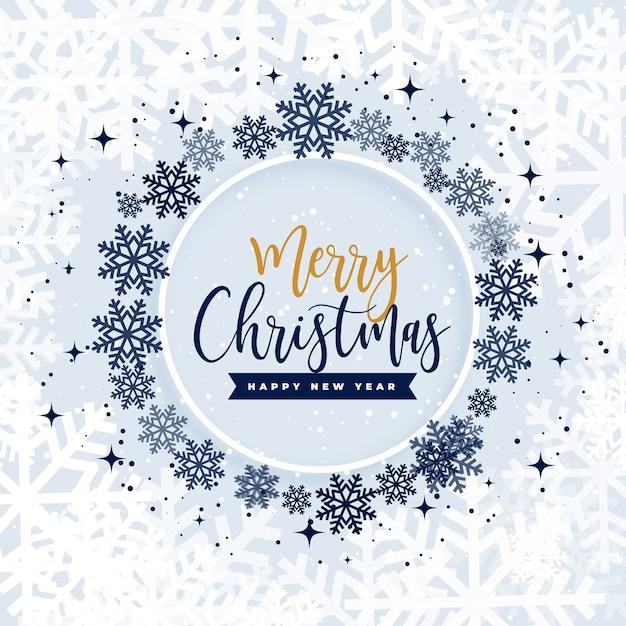 Wesołych świąt bożego narodzenia płatki śniegu w ramce koło Darmowych Wektorów