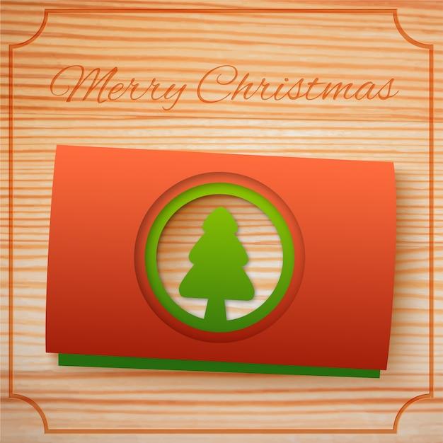 Wesołych świąt Bożego Narodzenia Pozdrowienie Szablon Z Czerwonymi, Zielonymi Kartonami Jodły Na Drewnie Darmowych Wektorów