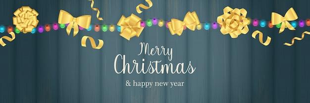 Wesołych świąt Bożego Narodzenia Transparent Z Złote łuki Na Niebieskim Drewnianym Podłożu Darmowych Wektorów
