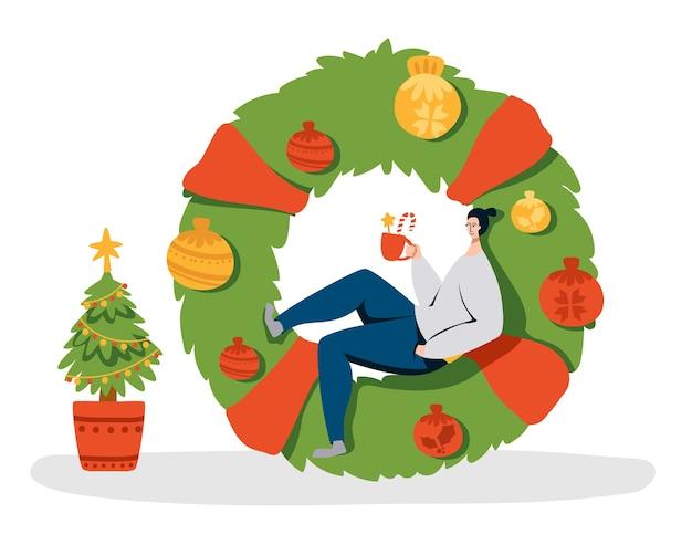 Wianek świąteczny, Drzewko I Malutki Ludzik Z Kubkiem Gorącej Kawy Na Ogromnym Zielonym Wieńcu Premium Wektorów