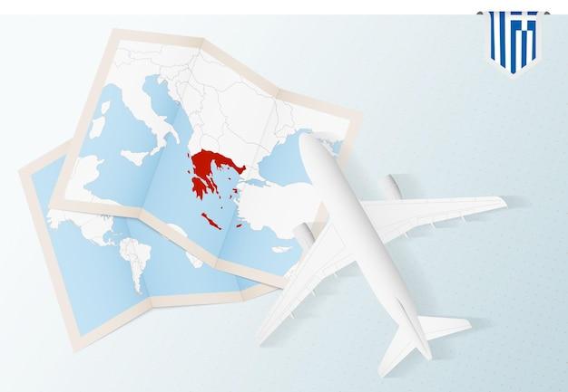 Widok Z Góry Samolot Z Mapą I Flagą Grecji Premium Wektorów