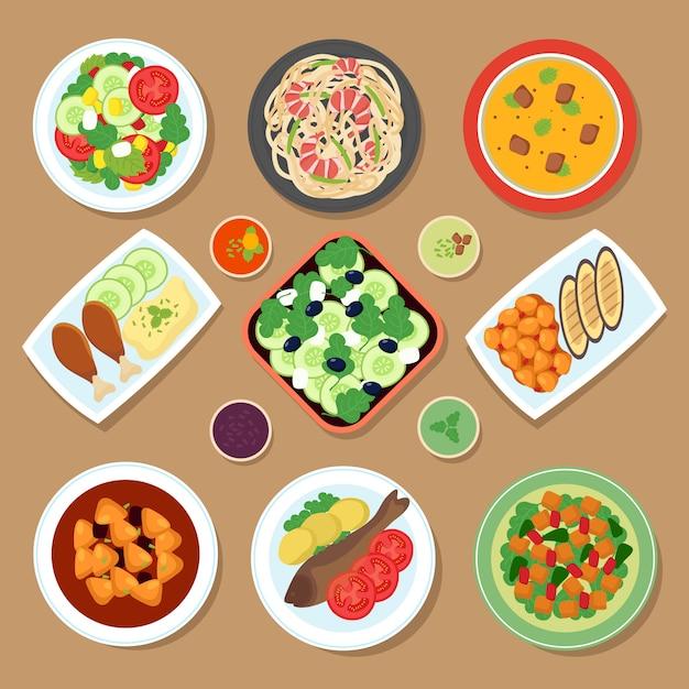 Widok z góry stół obiadowy z daniami europejskimi i daniem kuchni japońskiej Premium Wektorów