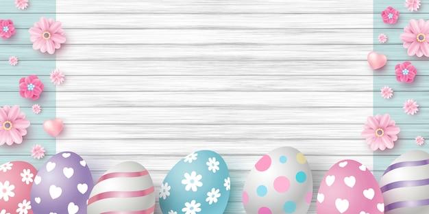 Wielkanocny dzień projekt jajka i kwiaty Premium Wektorów