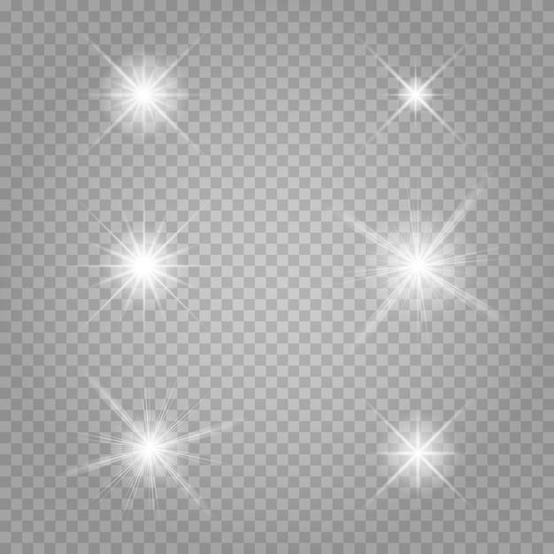 Zestaw gwiazd. białe świecące światło wybucha na przezroczystym. Premium Wektorów