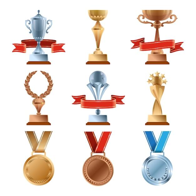 Zestaw różnych trofeów. mistrzowska nagroda złota. złoty, brązowy i srebrny medal oraz puchary zwycięzców. Premium Wektorów