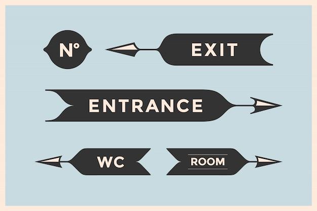 Zestaw starych strzał i banerów z napisem wejście, wyjście, pokój, wc Premium Wektorów
