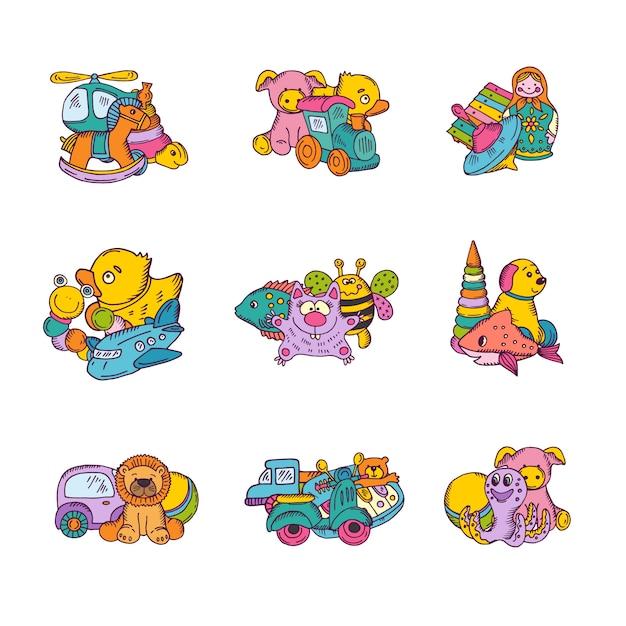 Zestaw stosów zabawek dla dzieci ręcznie rysowane i kolorowe Premium Wektorów