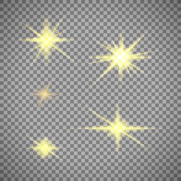 Zestaw złotych gwiazd światła na przezroczystym tle Darmowych Wektorów