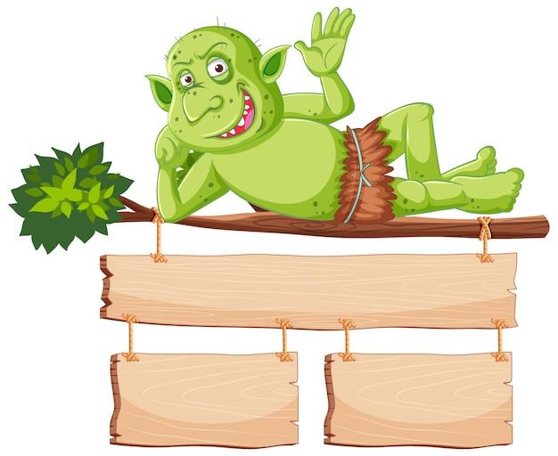 Zielony Goblin Lub Troll Uśmiech Podczas Leżenia Drzewa Z Pustym Sztandarem W Postaci Z Kreskówki Na Białym Tle Darmowych Wektorów