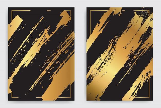 Złote i czarne tło obrysu pędzla Premium Wektorów